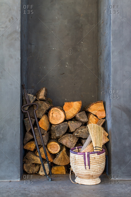 Firewood stacked by a wall