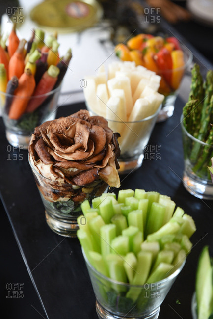 Vegetables served in glass cups on a bar