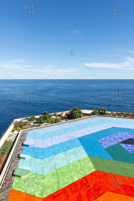 Monte Carlo, Monaco - September 19, 2016: Colorful mosaic pool overlooking the sea