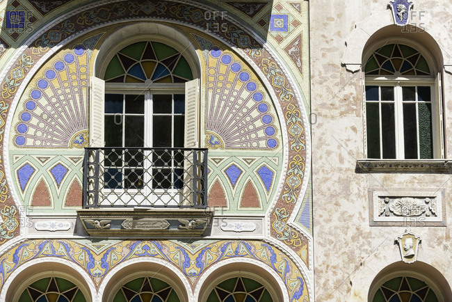 Stained glass window and balcony on a building in Monte Carlo
