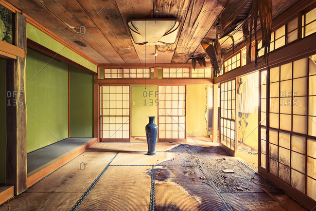Peeling ceiling and stains in a room in an abandoned Japanese house