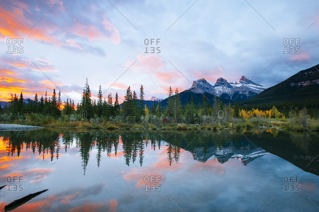 Mountain reflections in mountain lake at sunrise
