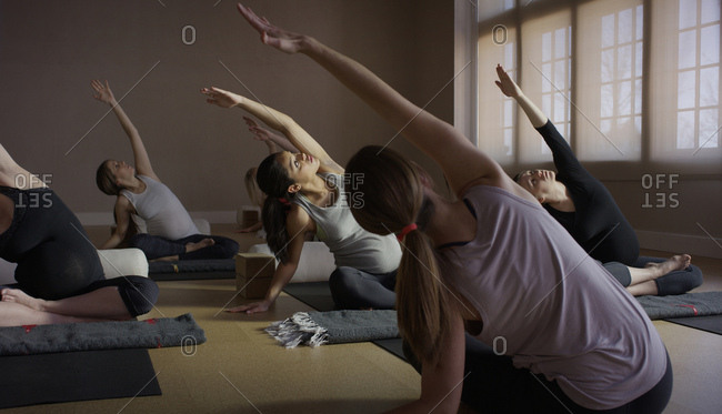 Selective focus view of tranquil women stretching in yoga class