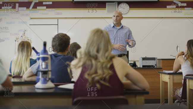 Selective focus view of teacher instructing students in science lab classroom