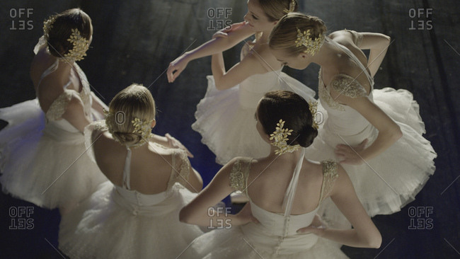 Overhead view of serious ballet dancers in costume standing backstage during show