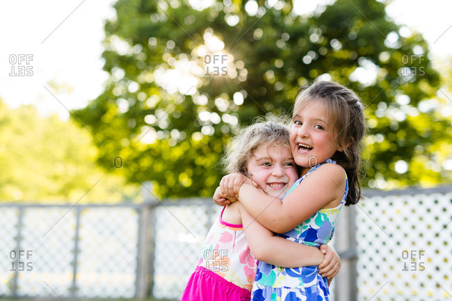 Portrait of two affectionate young sisters