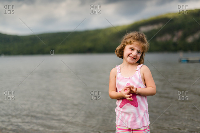 Portrait of smiling young girl at lake
