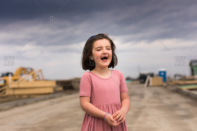Happy young girl at construction site