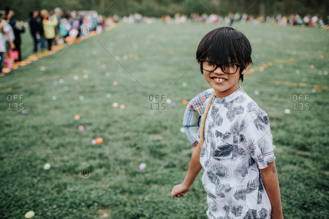 A boy with glasses at Easter egg hunt