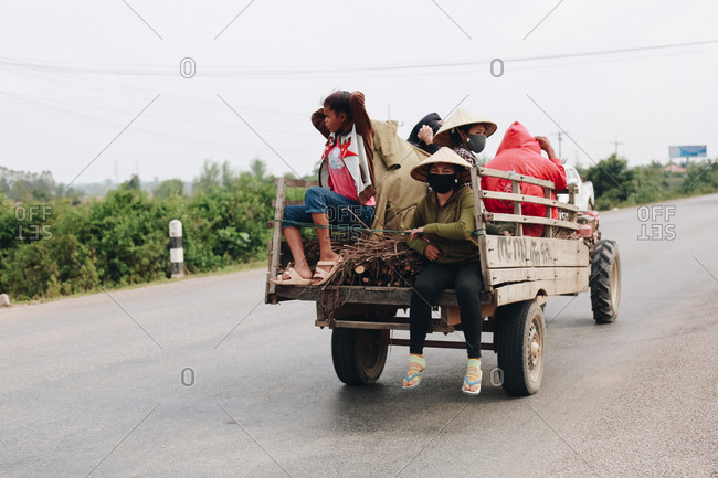 Laos - April 18, 2017: Women riding in back of truck