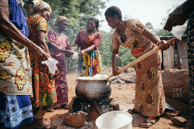 Ghana - January 19, 2015: Women cooking over outdoor fire