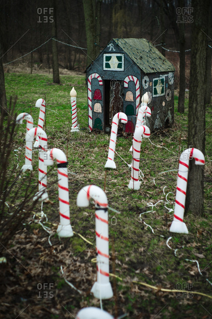 Holiday decorations with candy canes and a gingerbread house
