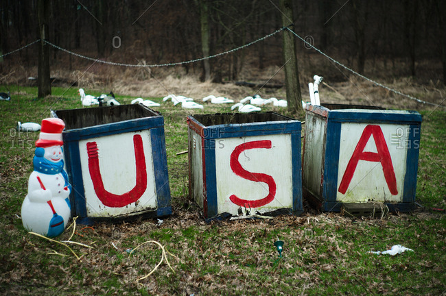 "Snowman holiday decoration beside boxes reading ""USA"""