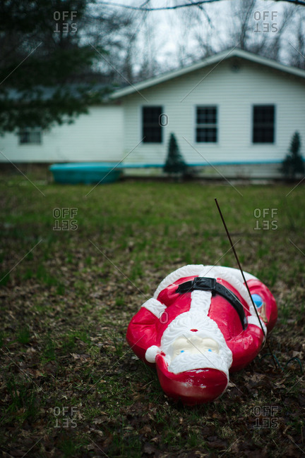 Santa decoration knocked over on front lawn