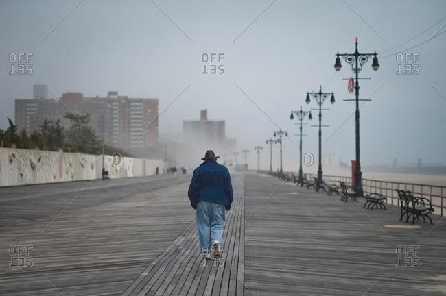Man walking on the Coney Island Boardwalk