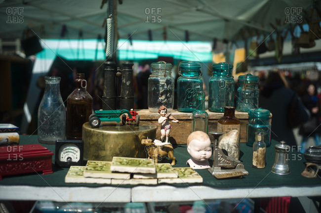 New York City, New York, USA - April 9, 2011: Glass jars and items for sale at Hell's Kitchen Flea Market, New York City