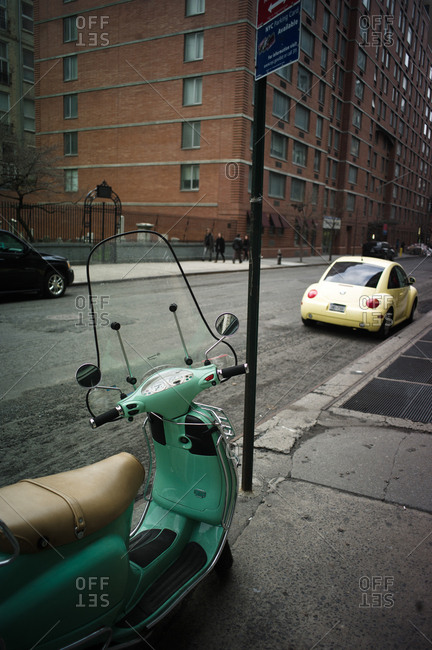 New York City, New York, USA - April 7, 2011: Green moped parked on the street near High Line Park in New York City