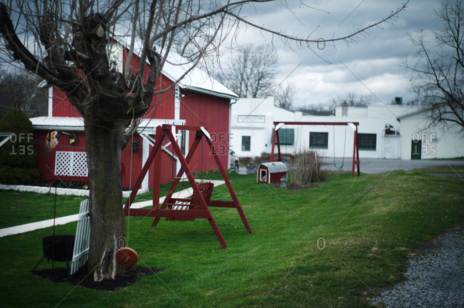 Backyard with red bard and swing in a small village in Ohio