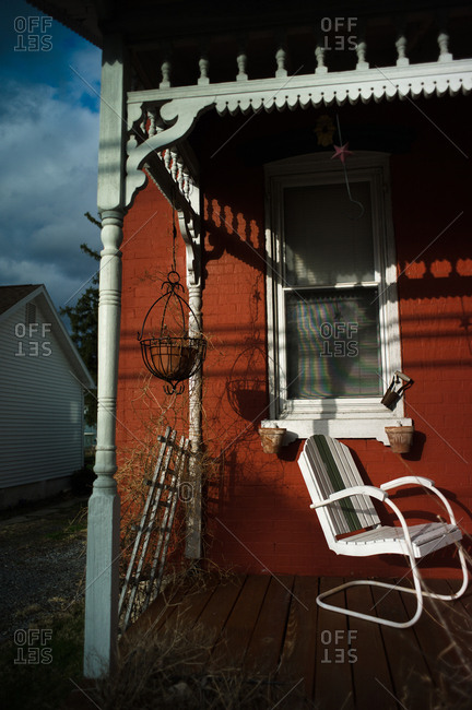 Red house with chair on front porch in a small town in Ohio