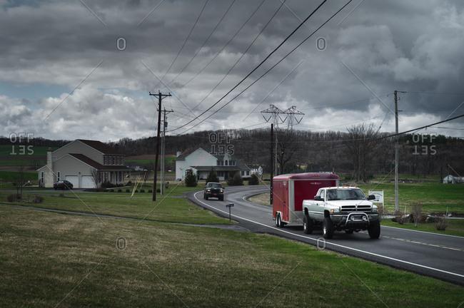 Ohio, USA - April 5, 2011: Trucks driving on rural road in Ohio