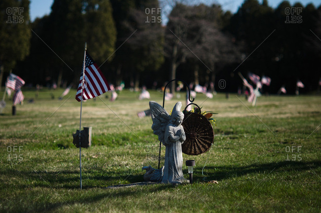 Cemetery with angel and American flag on grave