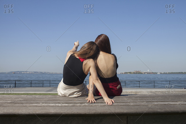 Back view of two young women sitting down