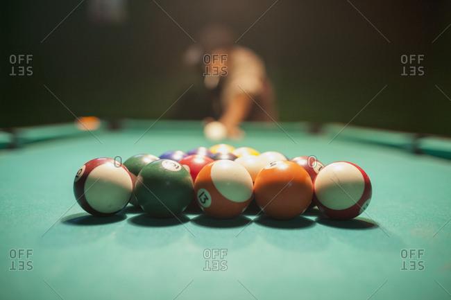 Pool balls on a pool table.