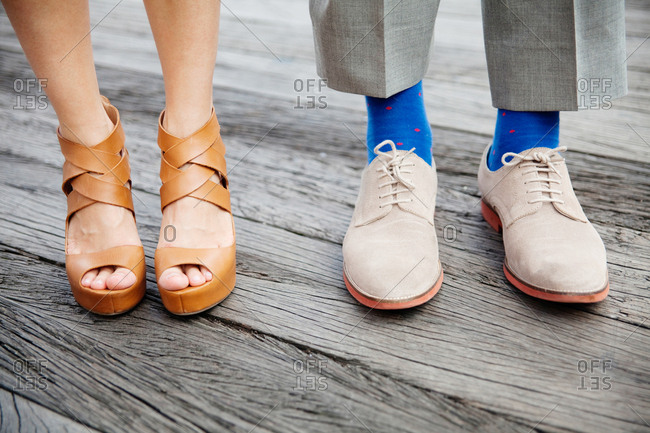 Close up of shoes worn by a bride and groom