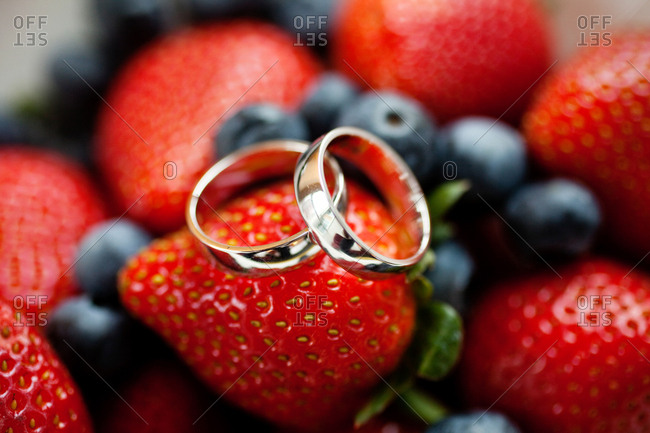 Wedding bands on a pile of berries