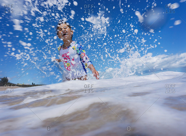 Girl playing in the crashing waves on Florida beach