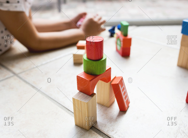 Stack of colorful toy blocks on the floor
