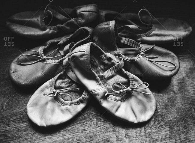 Three pairs of ballet slippers arranged from newest to oldest