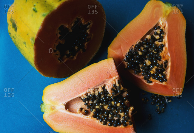 A fresh papaya cut in half