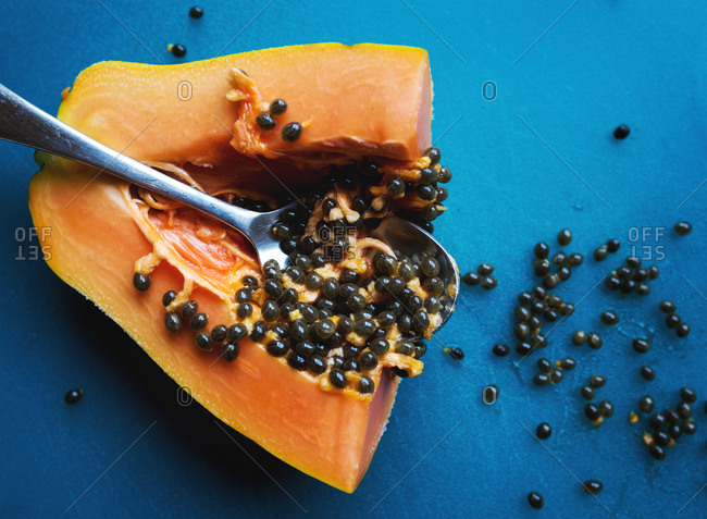 Piece of freshly cut papaya with spoon