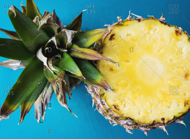A fresh pineapple with its top removed