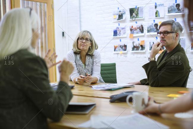 Business people brainstorming in meeting at board room
