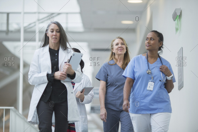 Female doctors walking in hospital corridor