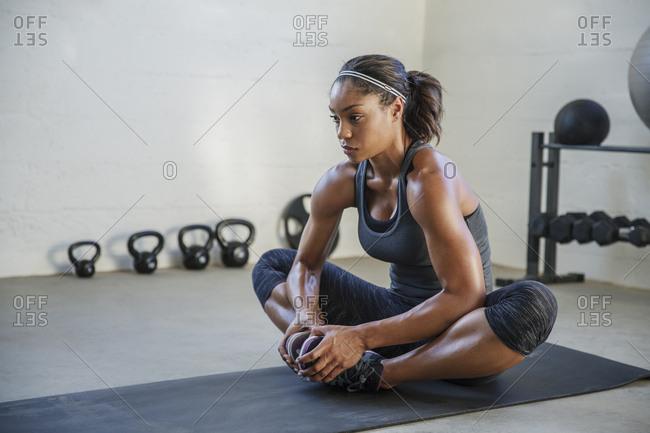 Female athlete exercising in health club
