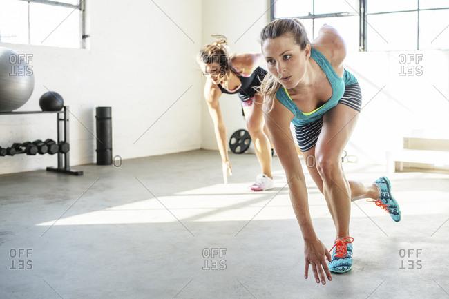 Confident athletes running in health club