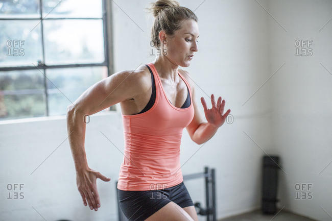 Female athlete jumping in health club