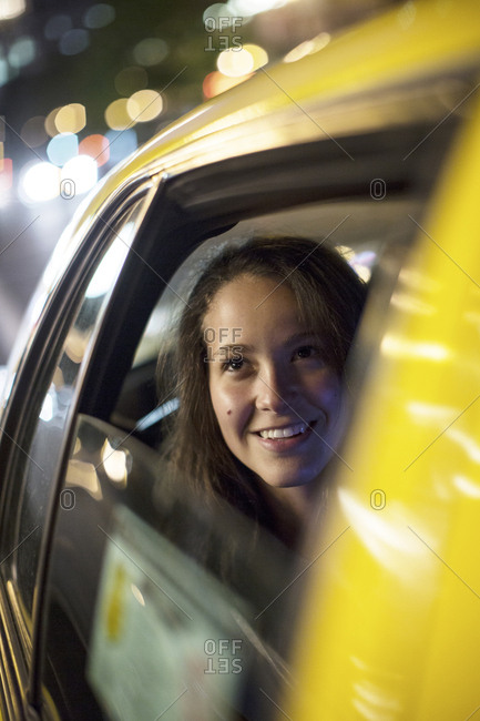 Close-up of thoughtful woman traveling in taxi