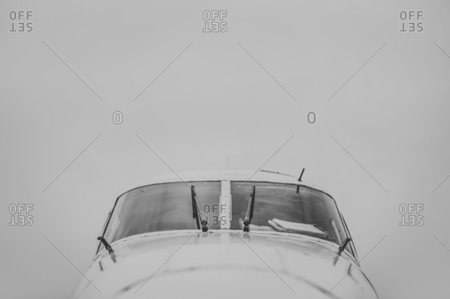 Airplane flying in sky during foggy weather