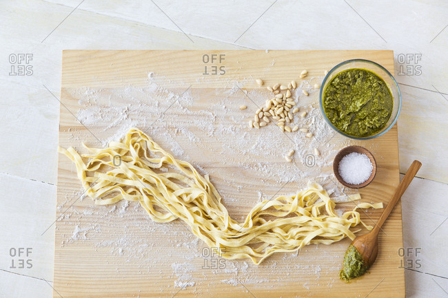Close-up of spaghetti by ingredients on cutting board