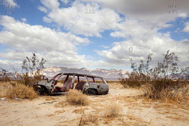 Wrecked car in barren area