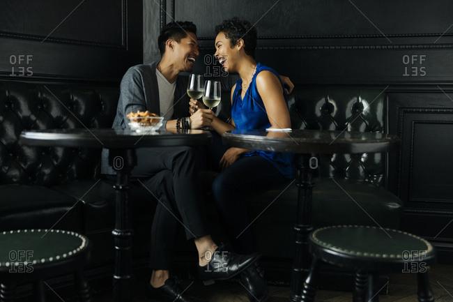 Cheerful couple having drinks in bar