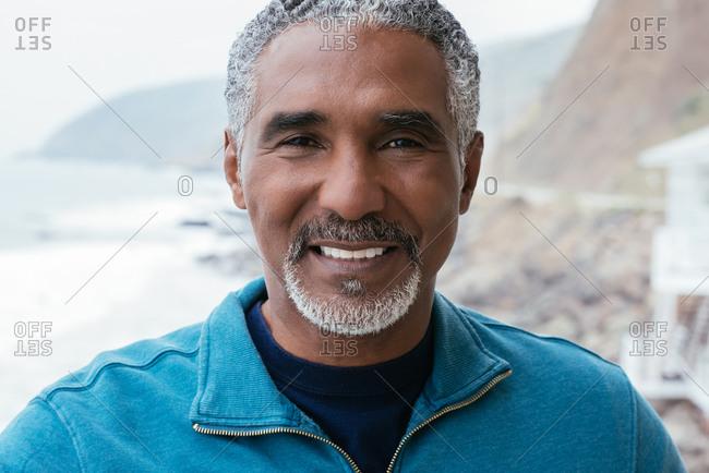 Portrait of confident mature man smiling