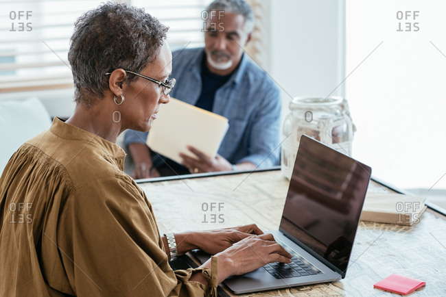 Mature woman using laptop in home office