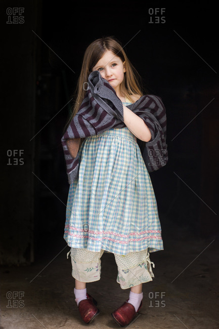Young girl in layers of clothes