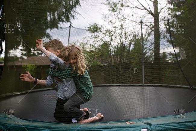 Boys wrestling on a trampoline