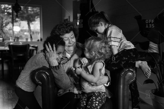 Grandma being greeted by kids